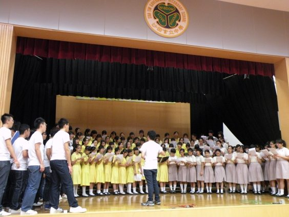 HKVC singing with secondary school choirs
